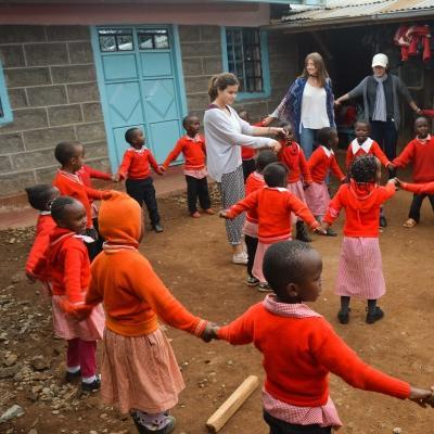 Projects Abroad volunteers assist with childcare volunteering for teenagers in Kenya as they play educational games with the children in the school yard